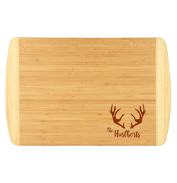 Custom antler bamboo cutting board with custom last name.  Laser engraved bamboo cutting board is perfect for a gift or house warming present.