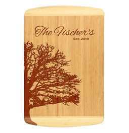 Unique bamboo cutting board design shows family tree outline and personalized with family name and established date.  Laser engraved for detailed look.